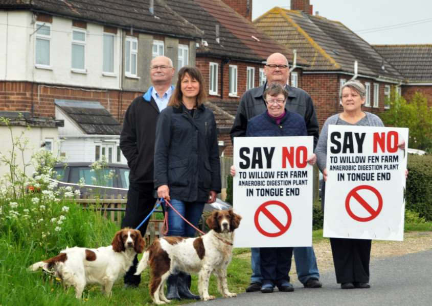 Jill Nutt (front centre) with (back) Nick Garner, Bill Marshall, (front) Jenya Bates, with dogs Meg and Galcha, and Helen Eve protest against plans for an anaerobic digester plant near their homes in Tongue End. Photo by Tim Wilson.