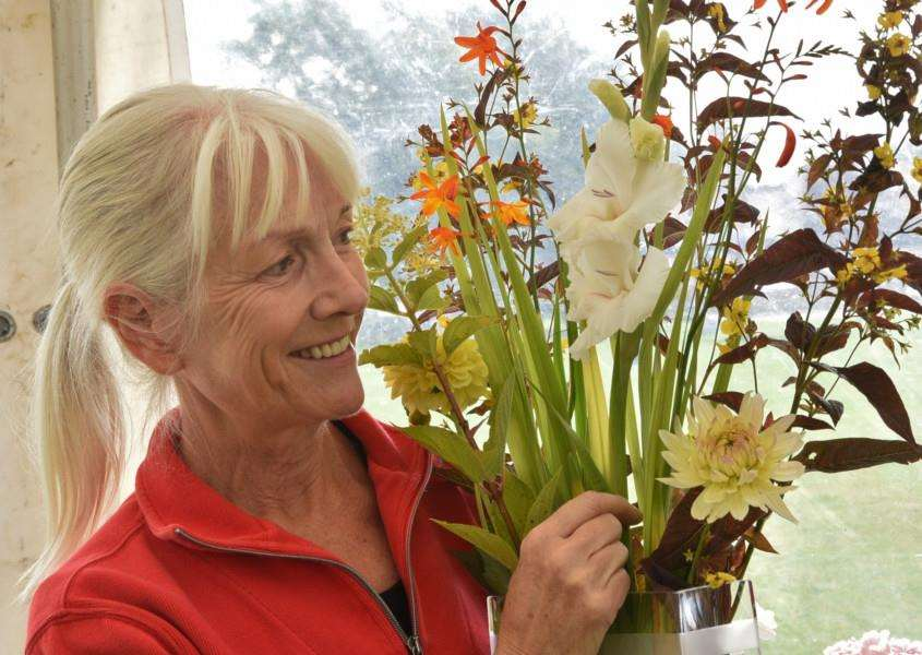 Uppingham Produce Show. Pauline Graveson with her display EMN-150208-212648009