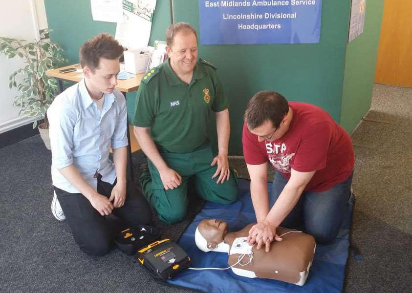 Steven Pratten with an automated external defibrillator.