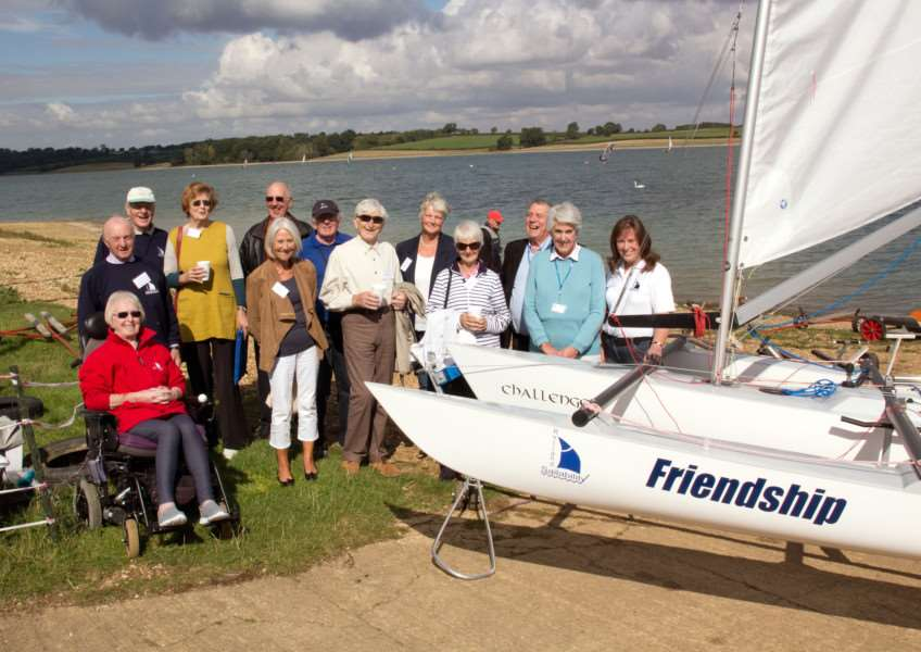 Volunteers and supporters from Rutland Sailability with the new boat Friendship EMN-150922-163653001