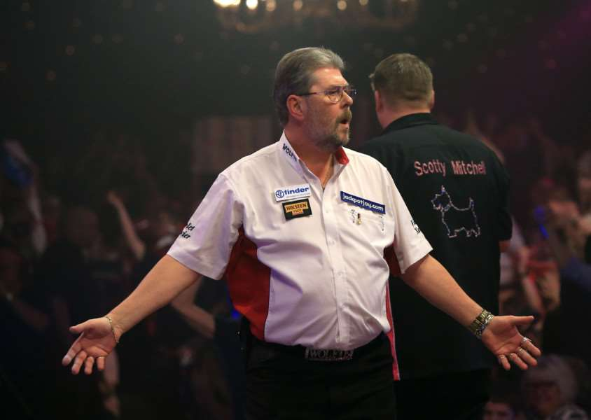 Martin Adams celebrates taking the match to a deciding set before eventually losing to Scott Mitchell during the 2015 BDO Lakeside World Professional Darts Championships at the Lakeside Complex. PRESS ASSOCIATION Photo. Picture Date: Sunday January 11, 2015. See PA story DARTS World. Photo credit should read: John Walton/PA Wire. DARTS_World_214697.JPG