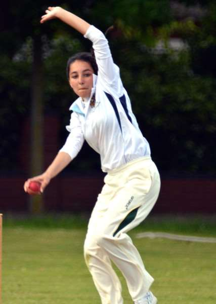 DEMON BOWLER: Amelia Gardner in action for Spalding 3rds. Photo by Tim Wilson.