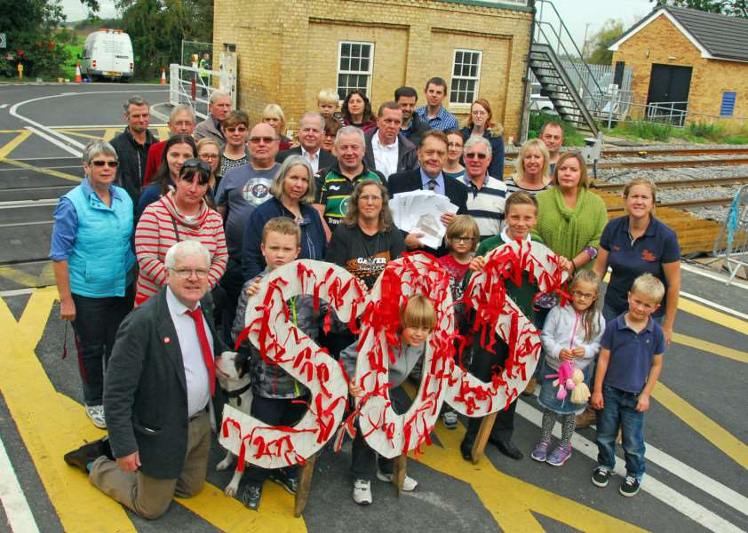 Protesters stage a red ribbon demonstration at St James Deeping signal box in September 2014 before its decommissioning by Network Rail one month later. Photo by Tim Wilson. SG270914-126TW.