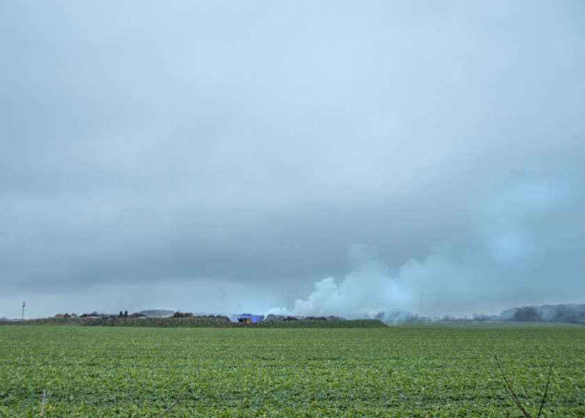 Smoke rising from the scene at Honey Pot Lane, Colsterworth, where 200 tonnes of compost was alight.