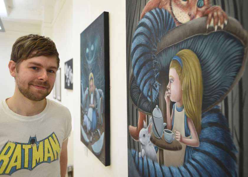 Local artist and Stamford College student Jason Duckmanton with his exhibition at the City Gallery, Peterborough Museum