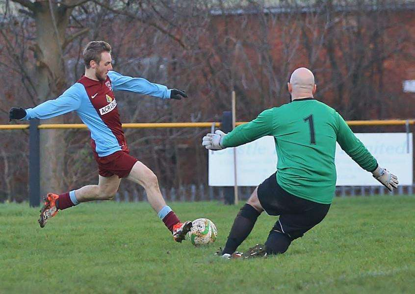 Scott Coupland shoots past Nirvana keeper James Flinders and the post during the United Counties League - Premier Division match between Leicester Nirvana and Deeping Rangers at Gleneagles Avenue, Leicester. England. on 30 January 2016. Photo by Will Kilpatrick. ANL-160102-080651002