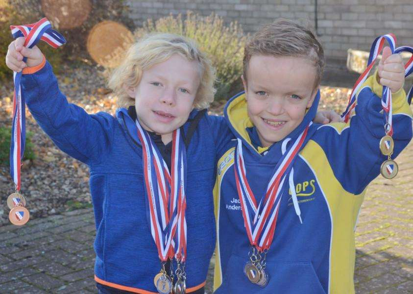 Joshua Waring, 10, and Jack Andersen, 11, from Bourne, with some of the medals they have won in regional events