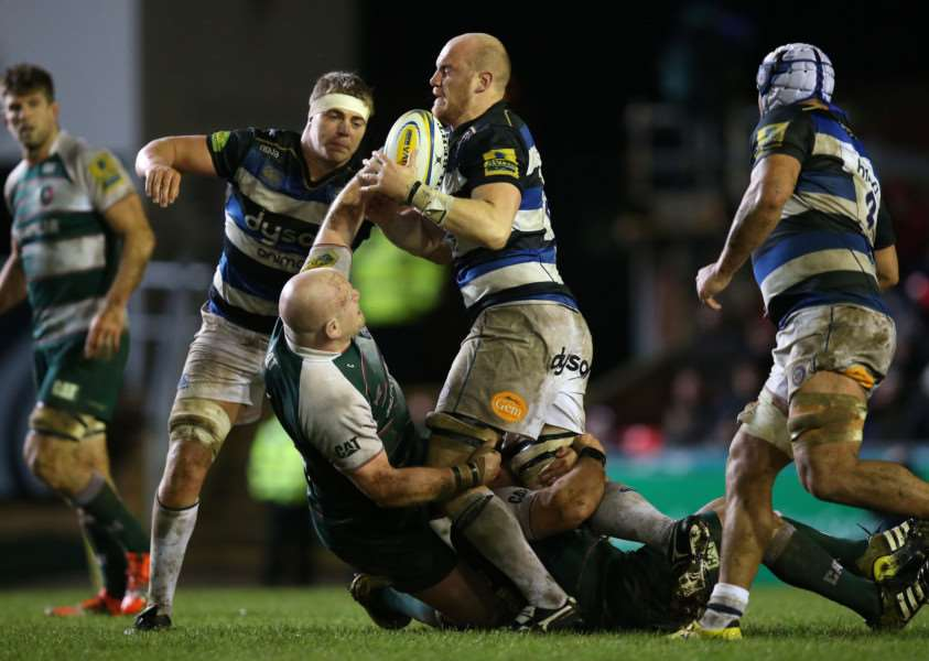 Leicester Tigers' Dan Cole tackles Bath's Matt Garvey during the Aviva Premiership match at Welford Road, Leicester. Photo: Mike Egerton/PA Wire. EMN-151130-164726001
