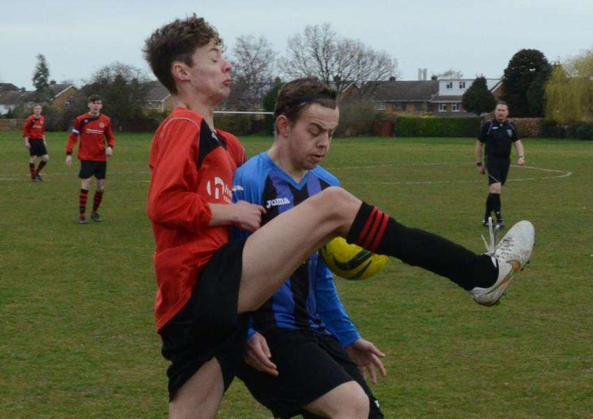 Action from Netherton Reserves v Baston FC at the Grange EMN-150321-173115009