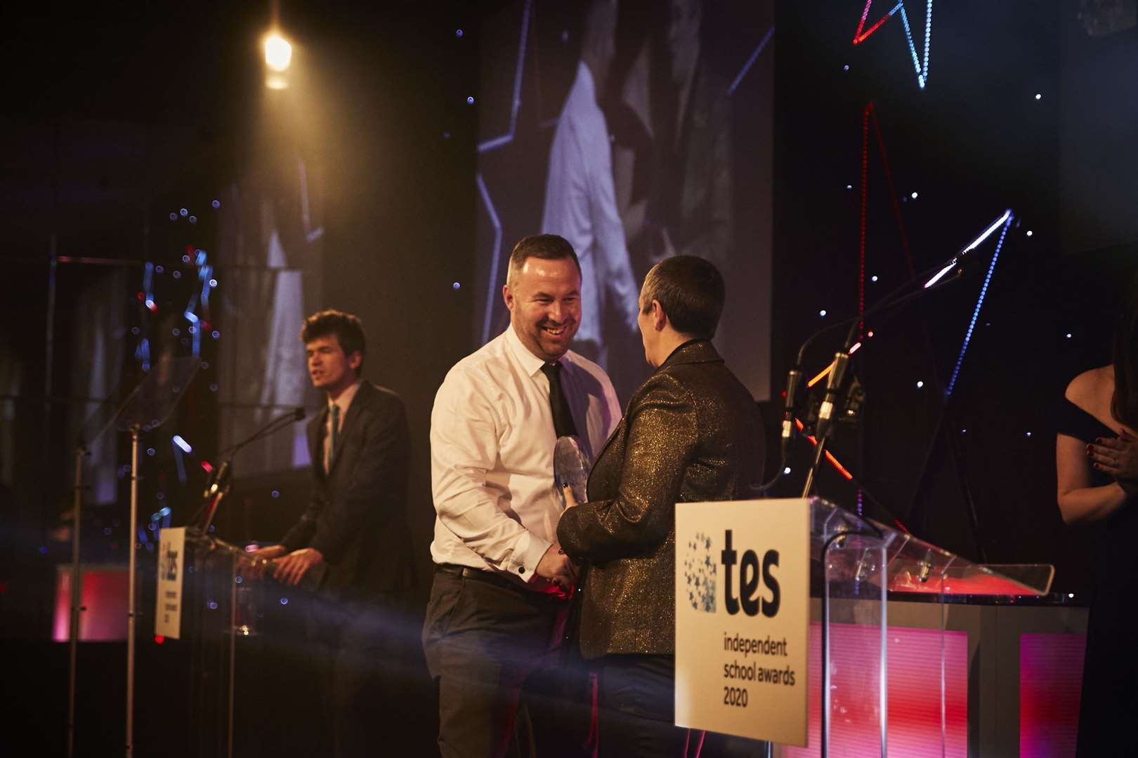 Senior team leader of Wilds Lodge School Simon Jugovic receives the award on stage