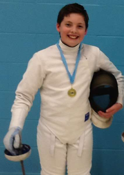 YOUNG MUSKETEER: William Ferguson wins gold at the Eastern Region Youth Fencing Championships at Cambridge University.