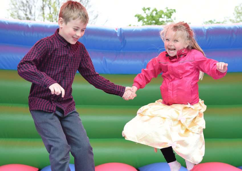 Noah and Isla Odell have fun on the bouncy castle