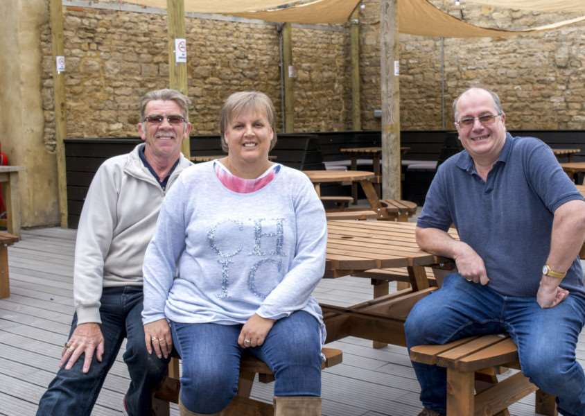 Bar manager, Malcolm Brown with licensees Carole Frith and Paul Frith. By Lee Hellwing.