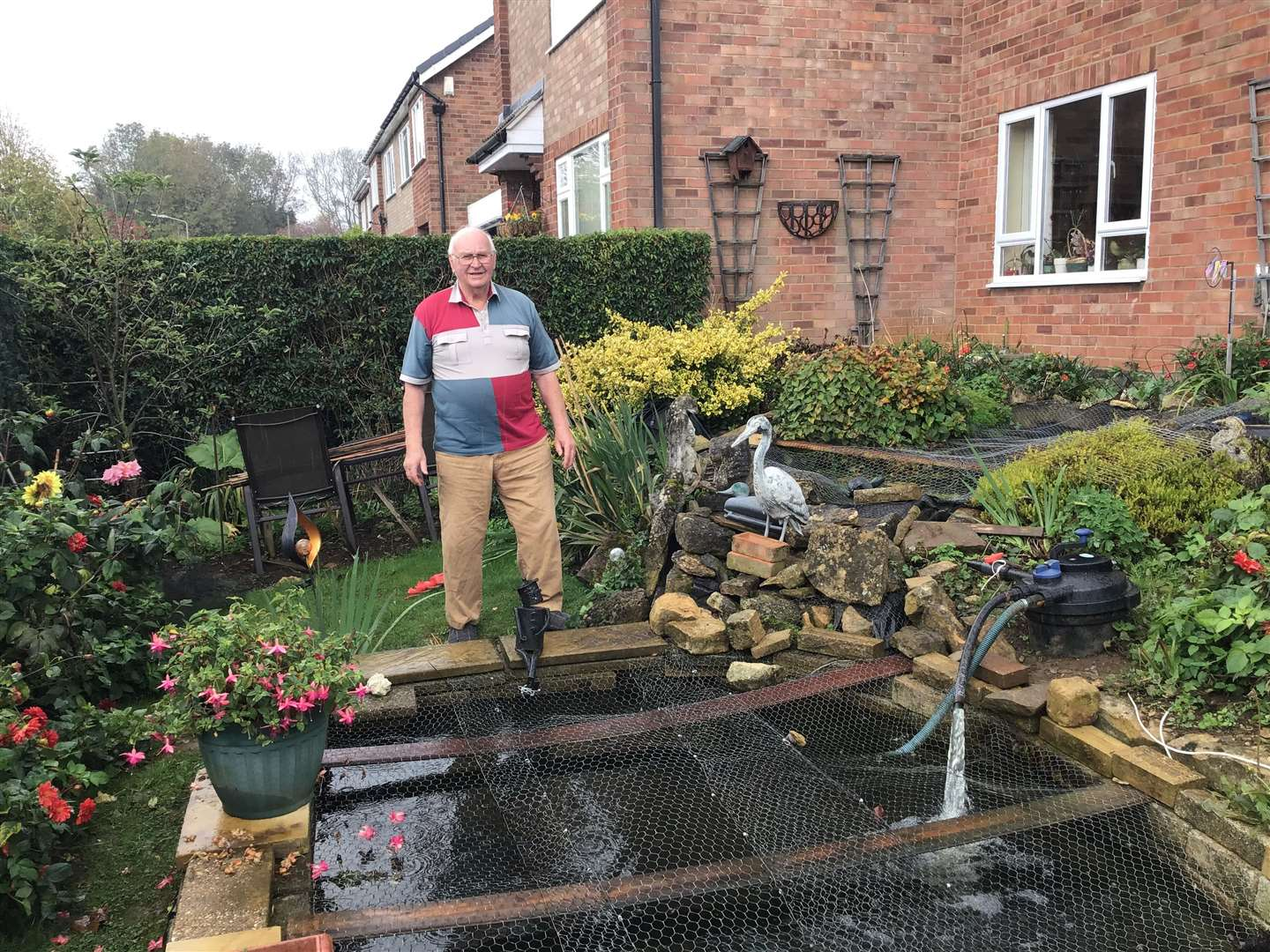 Ken Smith with his pond, which was emptied of fish by an otter.Photo: Ruth Smith