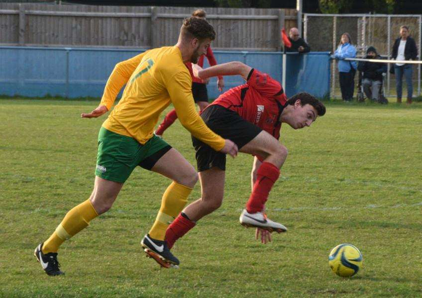 Oakham substitute Alex Brown muscles his way past Chris Hansford of Netherton. Photo: David Lowndes.