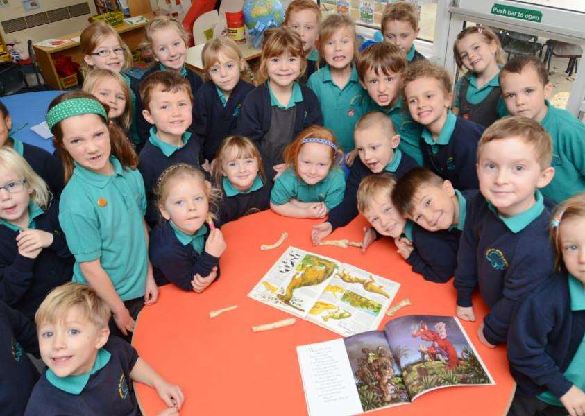 Year 1 pupils at Deeping st James CP school who made a story up about finding dinosaur bones on the school field EMN-151126-161907009