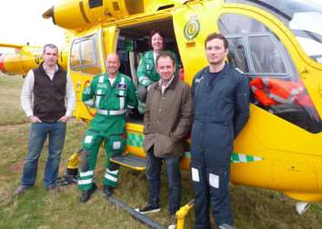 Donation to the Lincolnshire and Nottinghamshire Air Ambulance by representatives of Corby Glen Sheep Fair. Pictured are - Sheep Fair Clay Pigeon Shoot organiser Ben Burgoine, LNAACT Operations Manager Neil Clarke, Paramedic Jane Pattison, Sheep Fair Clay Pigeon Shoot Organiser Alan Bontoft, and LNAACT cover pilot Alistair.