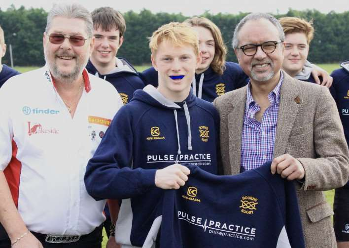"Bourne RUFC's under-17 rugby players are presented with their new kit by Martin ""Wolfie"" Adams and Joe Sunner, clinical director of Pulse Practice in Bourne. Photo by Simon Perkins."
