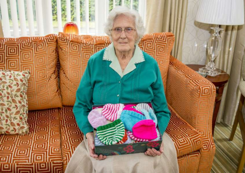 Doris Baker with a box of woolly hats she has knitted for Peterborough City Hospital. By Lee Hellwing.