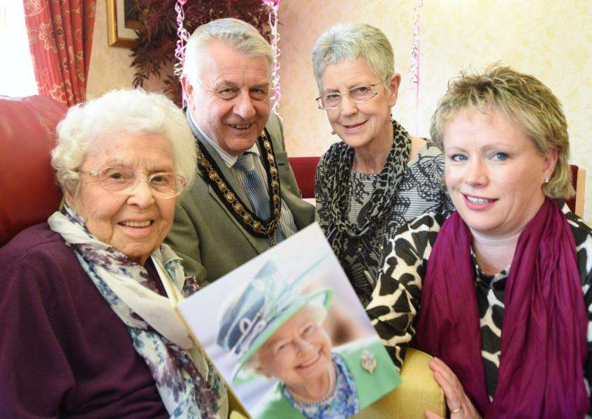 100-year-old Marjorie Carmichael, resdient at the Cedars care home, Bourne with mayor Philip Knowles, dsughter Sue Turner and granddaughter Michelle O'Gorman EMN-160330-161040009