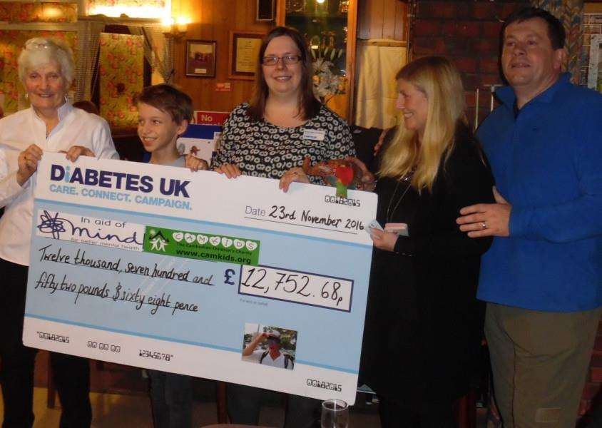 Ges and Mick Riley, right, present a cheque to Rachel Mann-Bradbury, representing Diabetes UK, Ketton Primary School pupil Jonty Williamson representing the school's adopted charity CamKids and the manager of the Stamford branch of Mind Vicky Easton.