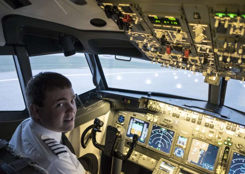 Jet Sim School founder Jonathan Lockton in his Boeing 737-800 simulator