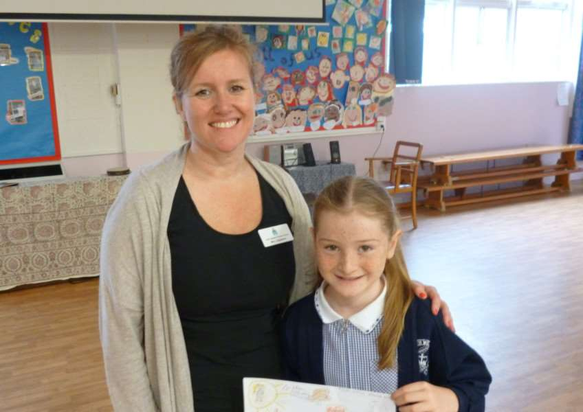 Edith Weston Primary School Jo Appleton (School Leader) and Skye Charters (Year 4 pupil), and the new front page of the website using Skye's initial sketch. EMN-140407-112447001