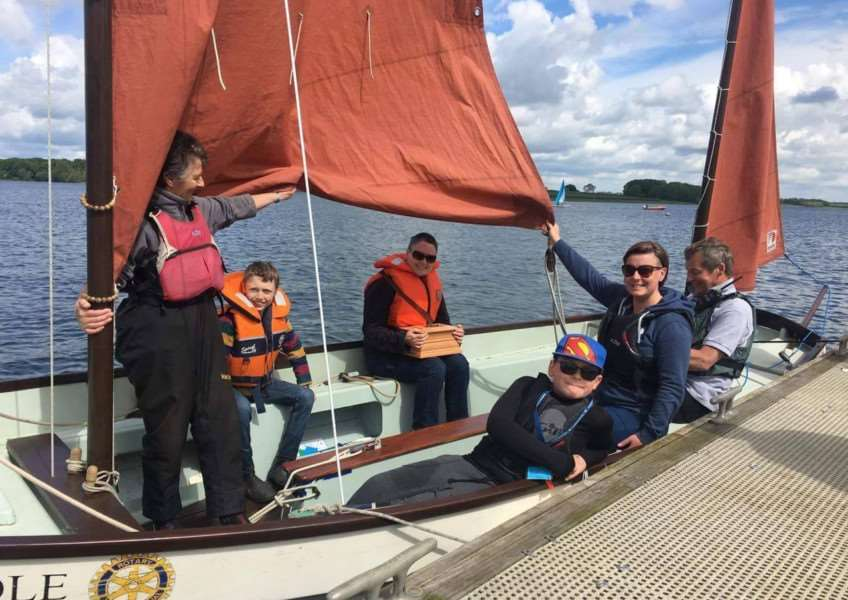 Alex Sismey sailing at Rutland Water with Roger's ashes with her friends and staff from Rutland Sailability. Submitted