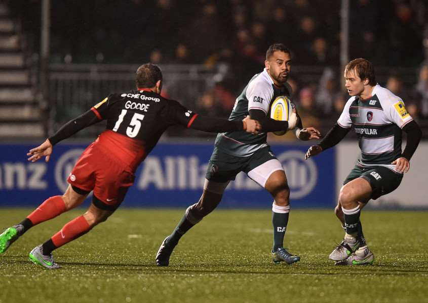 Leicester Tigers' Telusa Veainu (centre) gets away from Saracens' Alex Goode during the Aviva Premiership match at Allianz Park, London. Photo: Andrew Matthews/PA Wire EMN-160401-161017001