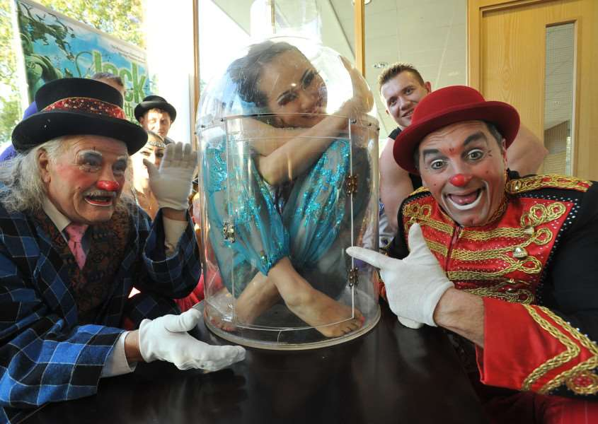 Wonder Circus at the Embankment. Lady inside the bottle with clowns Charlie and Mr Fips.