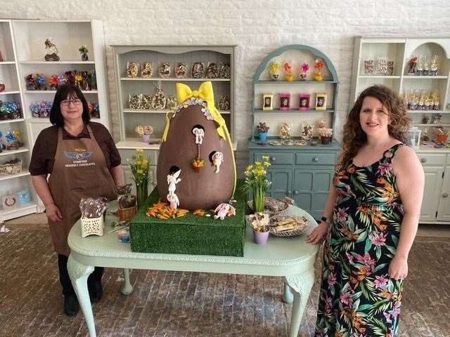 Laura Kendrick, winner of the giant chocolate Easter egg, with Barbara Farrow, left, of Stamford Heavenly Chocolates.