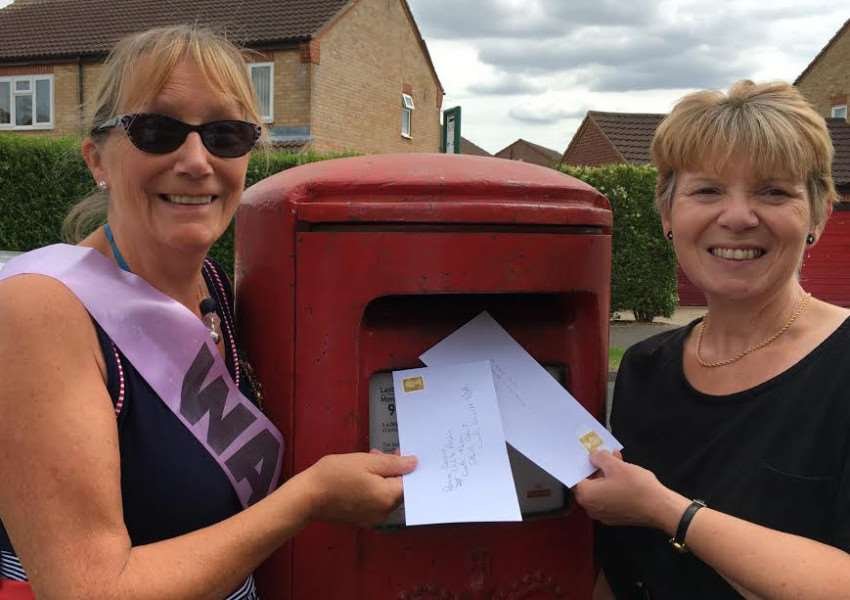 Trish McGregor left and Linda Cuthbertson post their letters to the DWP.