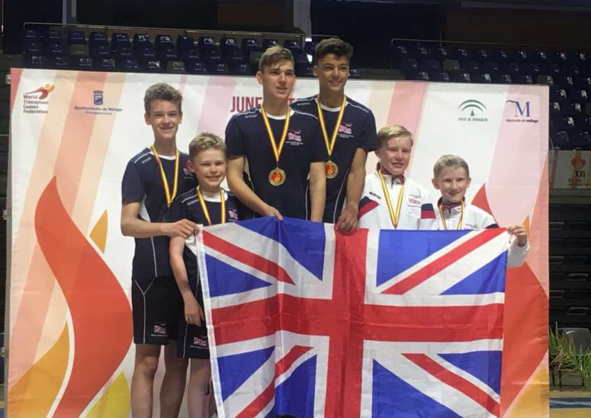 Alex Gibbs, far right, with badminton partner Robert Collins and fellow athletes