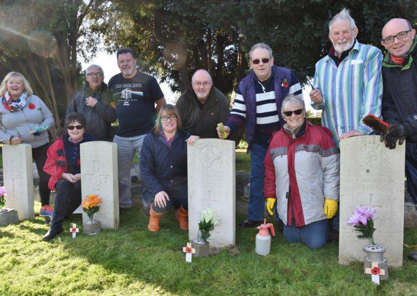 Members of the Veterans breakfast club at Bourne cleaning Commonwealth graves at the cemetery prior to Remembrance Day EMN-160611-115650009