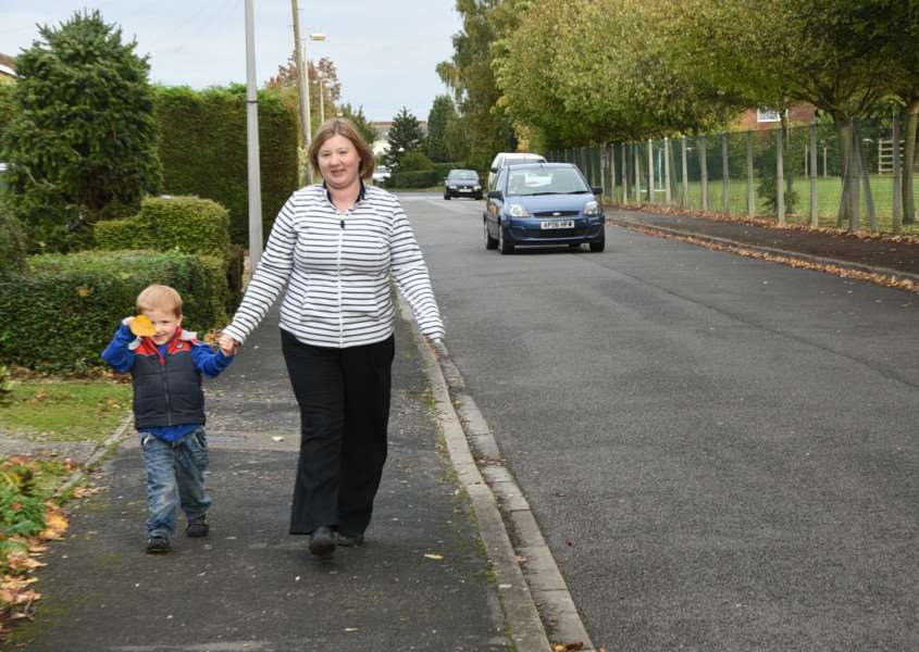 Jenny Pace with her children Timothy (4) and Benjamin (5). They are campaigning for a one way system near the Bourne Westfield primary school EMN-150710-193016009