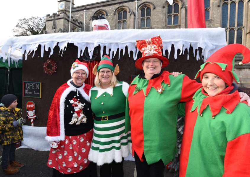 Jane Araral, Elaine Mothers, Gill Clarke and Jenny Orford with the grotto during Stamford Christmas Market