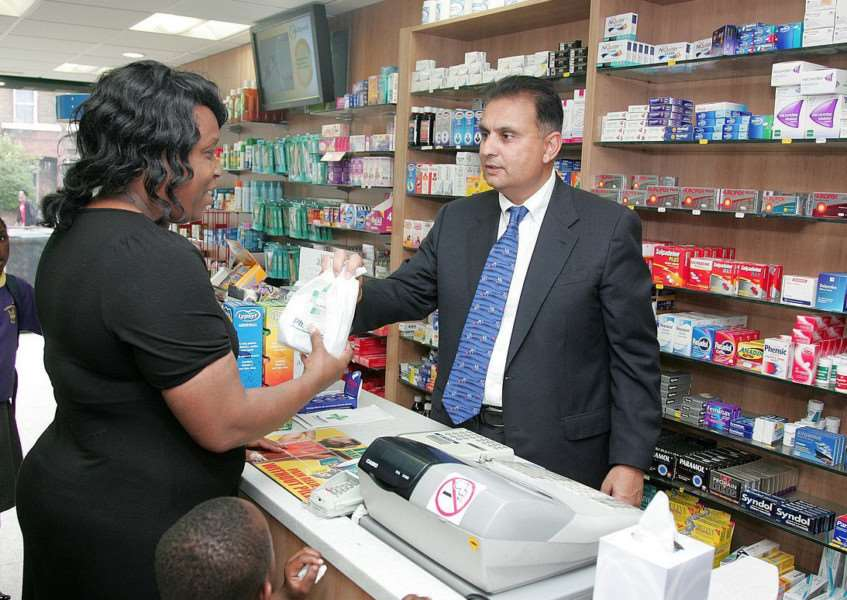 A pharmacist behind the counter serving a woman as part of NHS England in Lincolnshire's 'Don't Let Minor Illness Become A Major Problem' campaign. ''''Copyright: �Crown Copyright.
