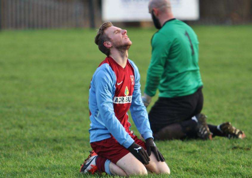 Scott Coupland looks dejected after shooting wide during the United Counties League - Premier Division match between Leicester Nirvana and Deeping Rangers at Gleneagles Avenue, Leicester. England. on 30 January 2016. Photo by Will Kilpatrick. ANL-160102-080417002