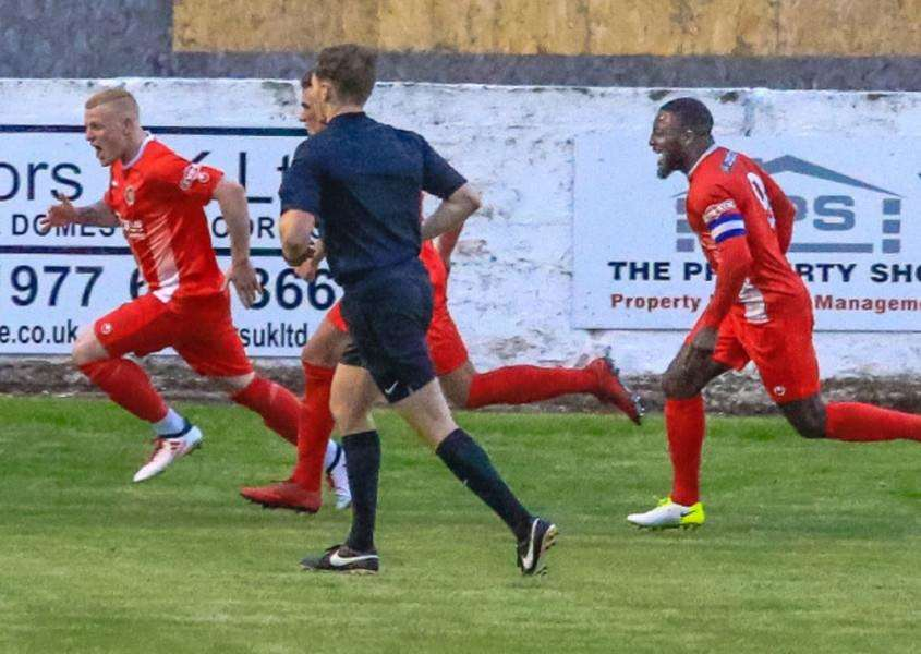 Kieran Wells races away to celebrate after scoring the second goal in Tuesday's night play-off semi-final success at Frickley Athletic.
