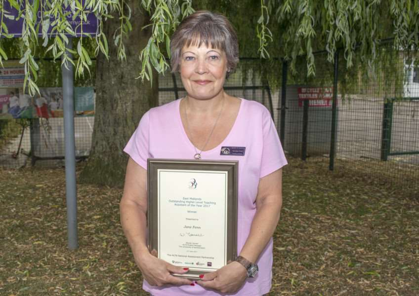 Jane Fenn, Ryhall Academy teaching assistant, with her certificate