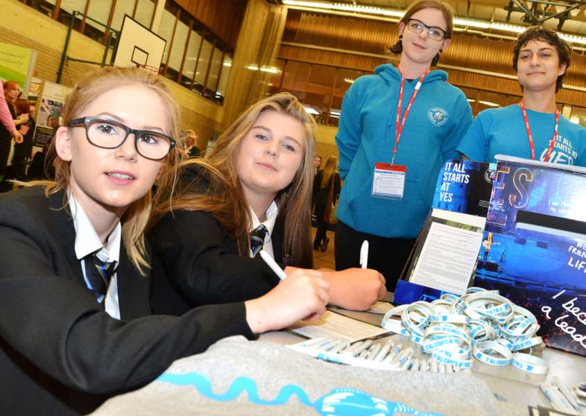 Year 11 students Megan Wellen and Emily Gill find out about National Citizen Service opportunities from Rosella Gugliotta and Frances Pearson. Photo by Tim Wilson.
