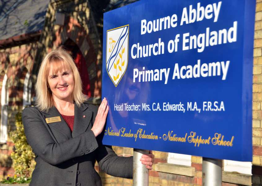 Retiring executive headteacher Cherry Edwards OBE outside Bourne Abbey C of E Primary Academy. Photo by Tim Wilson.