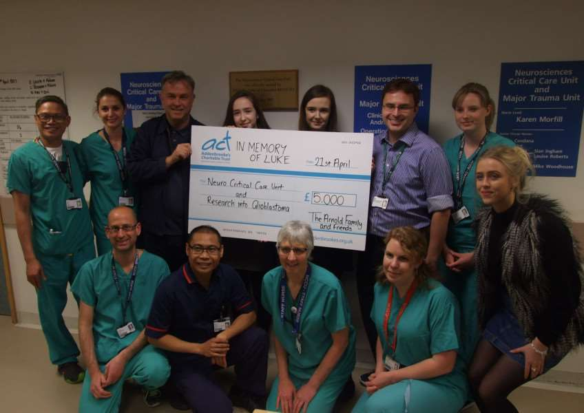 Luke's family handing over a cheque for �5000 to staff from the Addenbrooke's Hospital, Neuro Critical Care Unit. Submitted.
