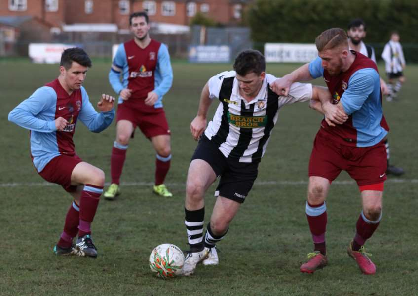 Tom Smith (left) and Jonny Clay hold off Star scorer James Hill -Seekings. Photos by Tim Gates