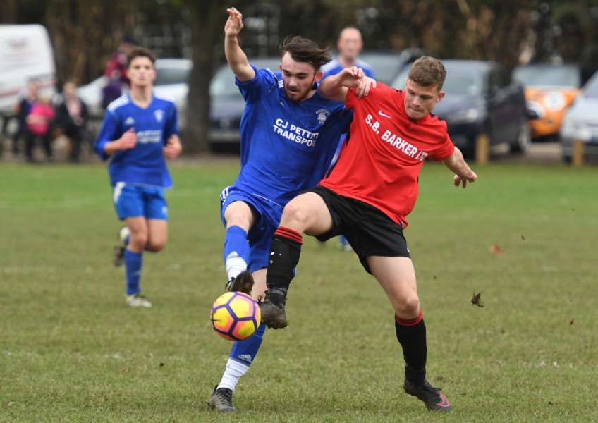 Fishtoft's Reece Sullivan challenges Brandon Rylett of Coningsby Reserves.