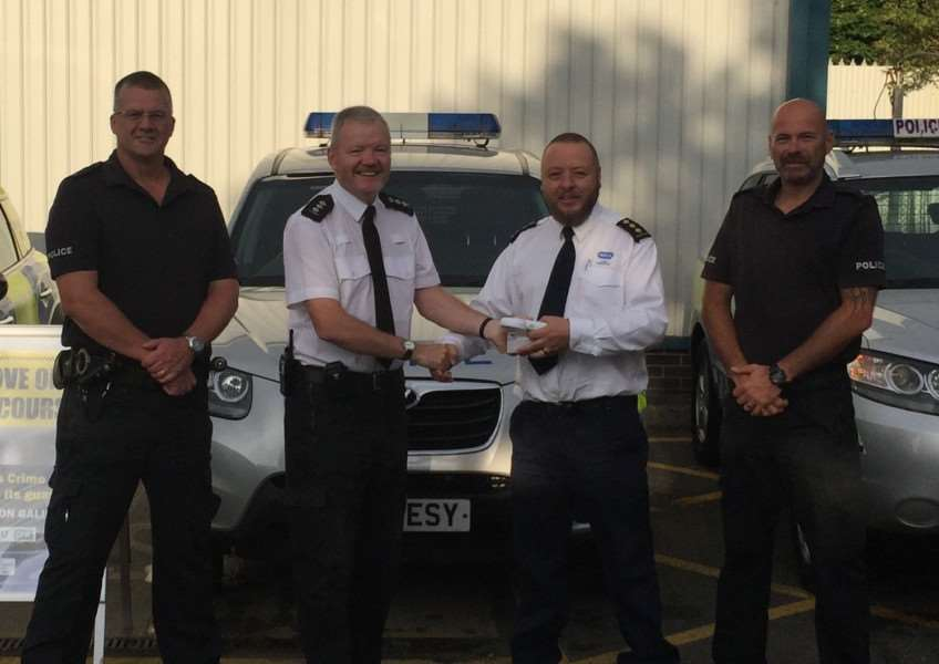 RSPCA Chief Inspector John Lawson presents one of the new scanners to Lincolnshire Police's Rural Crime Team. Left to right: PC Martin Green, Chief Inspector Jim Tyner, RSPCA Chief Inspector John Lawson and PC Bud Perring.