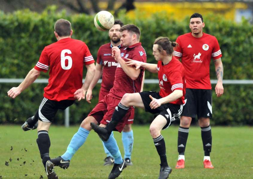 Andrew Moss in the thick of the action for Bourne in Saturday's victory over Irchester.