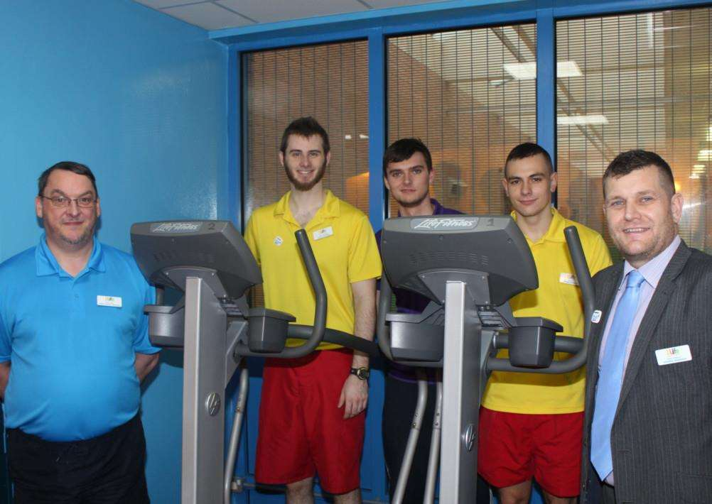 Bourne Leisure Centre staff Paul Jarvis, Bradley Wilcox, Chris Quinlan and Andrei Petrov and Centre Manager, David Downes in the newly painted gym. EMN-141230-161906001