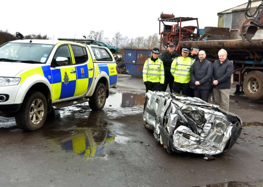 PLAYING CATCH-UP: Sergeant Leanne Carr, PC Martin Green, Acting Assistant Chief Constable Paul Gibson, PC Nick Willey, Police and Crime Commissioner Marc Jones and his deputy Stuart Tweedale see a vehicle previously used in hare coursing in the Deepings last year. Photo by Tim Wilson. SG230217-113TW.