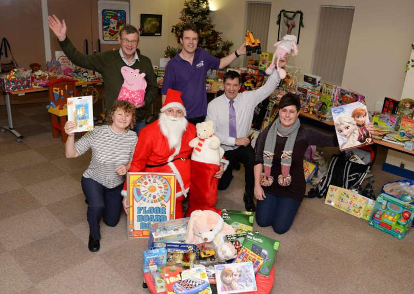 Gifts donated to Voluntary Action Rutland's Christmas appeal 2015. Kevin O'Brien, Dawn Citrine, Richard Auciello, Jim Freeborough, Marie Pears and Rob Persani.''Photo: Alan Walters MSMP-15-12-15-aw002 EMN-151216-144453001